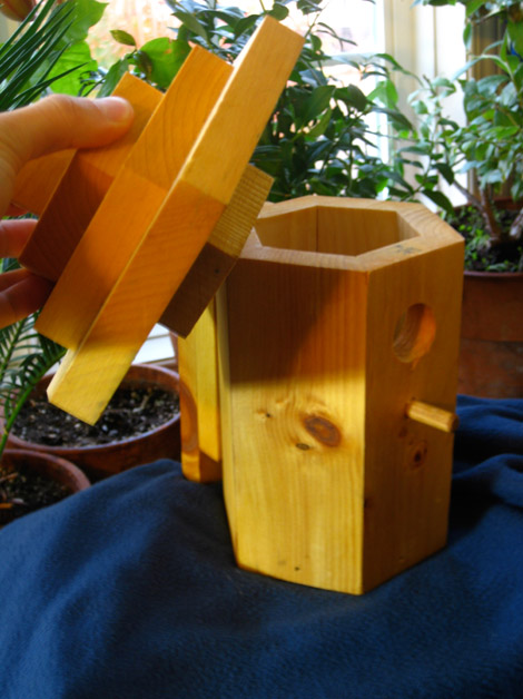A birdhouse that opens from the top does not disturb the nest and is easy to clean