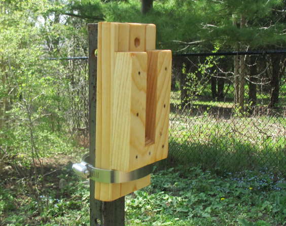 A wooden mounting bracket to make it easy to hang a birdhouse