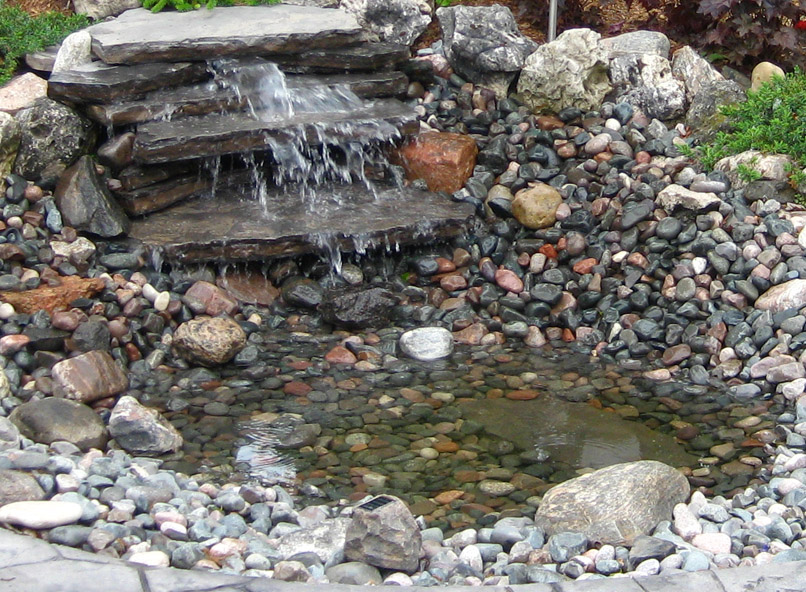Pondless waterfall for attracting birds to your backyard